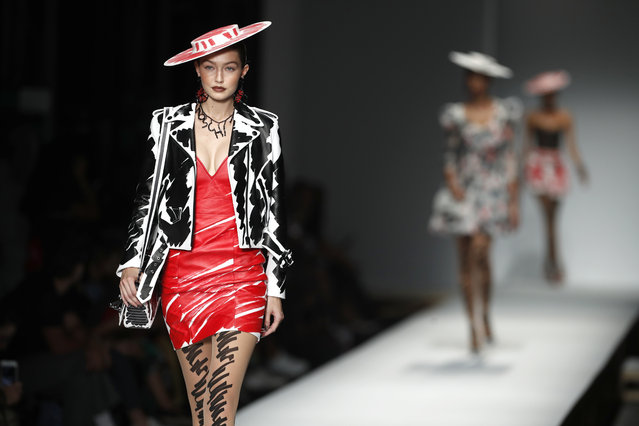 Model Gigi Hadid wears a creation as part of the Moschino women's 2019 Spring-Summer collection, unveiled during the Fashion Week in Milan, Italy, Thursday, September 20, 2018. (Photo by Antonio Calanni/AP Photo)