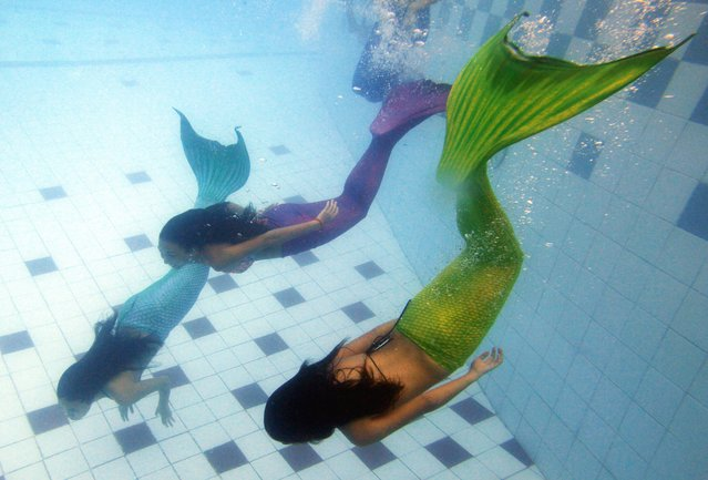 Filipino students practice during a mermaid swimming lesson by the Philippines Mermaid Swimming Academy in a private swimming pool in Makati, Manila, Philippines, 15 June 2013. The Philippine Mermaid Swimming Academy (PMSA) was created in 2012 in Boracay by Normeth Preglo of The Philippines and US swimming instructor Djuna Rocha. The swimming lessons were brought to Manila in April 2013. The price for a two-hour class is 37 US dollars. (Photo by Dennis M. Sabangan/EPA)