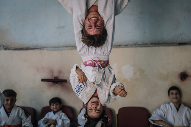 Sports Story Third Prize. Children practise during a karate lesson in Aleppo, Syria. (Photo by Anas Alkarboutli/dpa/Istanbul Photo Awards 2021)