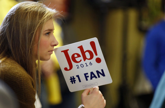 Syndey Walker listens as her choice, Republican presidential candidate, former Florida Gov. Jeb Bush speaks during a campaign stop at Souhegan High School, Saturday, January 16, 2016, in Amherst, N.H. (Photo by Jim Cole/AP Photo)