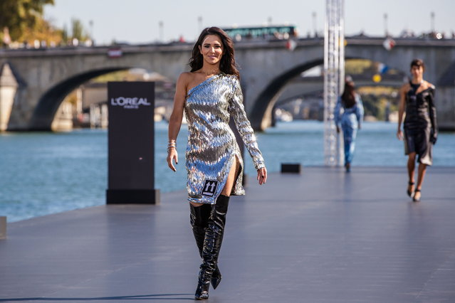 British singer Cheryl Cole presents a creation as part of a fashion show organized by cosmetics company L'Oreal on the Seine, during the Paris Fashion Week, in Paris, France, 30 September 2018. (Photo by Christophe Petit Tesson/EPA/EFE)