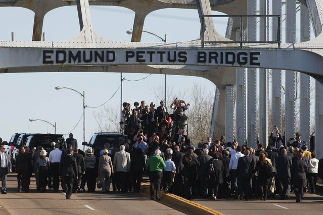A media truck drives ahead to capture U.S. President Barack Obama leading a march across the Edmund Pettus Bridge in Selma, Alabama March 7, 2015. With a nod to ongoing U.S. racial tension and attempts to limit voting rights, Obama declared the work of the Civil Rights Movement advanced but unfinished on Saturday on a visit to the Alabama bridge that spawned a landmark voting law.  REUTERS/Tami Chappell  (UNITED STATES - Tags: POLITICS ANNIVERSARY SOCIETY MEDIA)