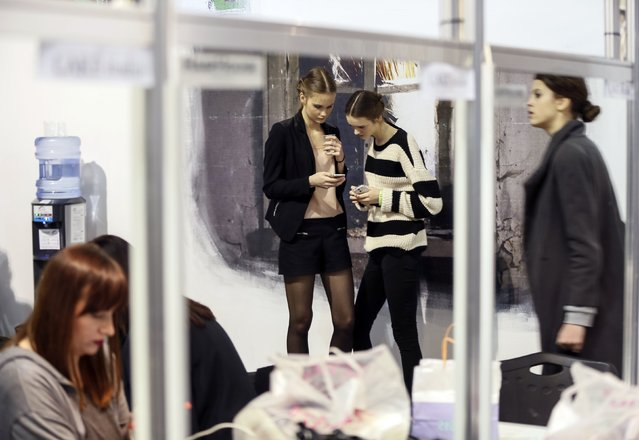 Models wait backstage during Ukrainian Fashion Week in Kiev, March 18, 2015. (Photo by Gleb Garanich/Reuters)