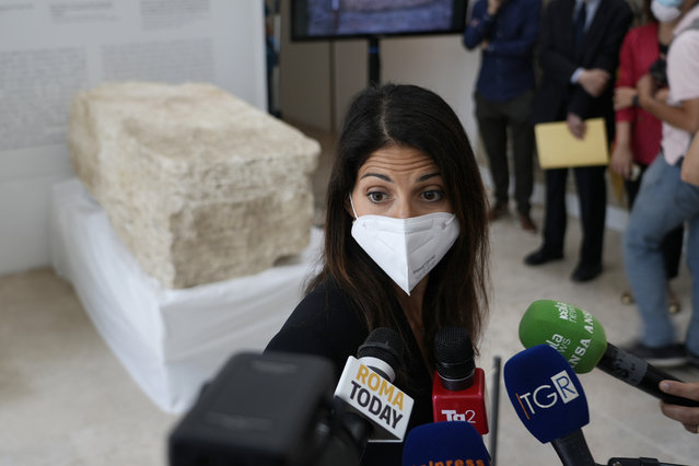 """Rome's Mayor Virginia Raggi, answers to journalists' questions, during the presentation to the press of an archeological finding emerged during the excavations at a Mausoleum in Rome, Friday, July 16, 2021. The monumental pomerial stone is dating back to Roman Emperor Claudio and was used to mark the """"pomerium"""" the sacred boundaries of the """"Urbe"""", the city of Rome, during the Roman empire. (Photo by Domenico Stinellis/AP Photo)"""