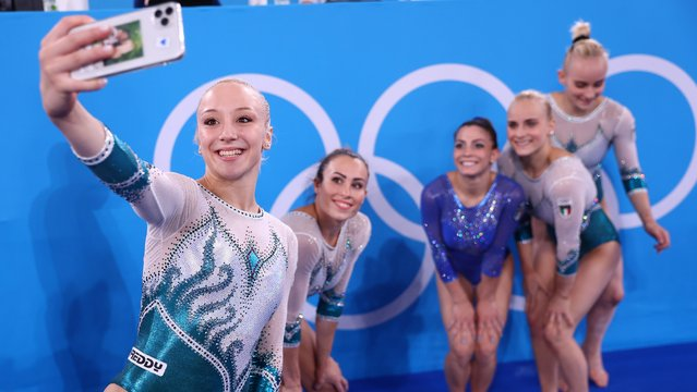Martina Maggio, Alice D'Amato, Lara Mori, Asia D'Amato, and Vanessa Ferrari of Team Italy pose in front of the rings during Women's Qualification on day two of the Tokyo 2020 Olympic Games at Ariake Gymnastics Centre on July 25, 2021 in Tokyo, Japan. (Photo by Mike Blake/Reuters)