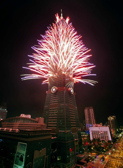 A fireworks display is set off from the Taipei101 skyscraper during New Year's Eve celebrations in Taipei, Taiwan. (Photo by Wally Santana/Associated Press)