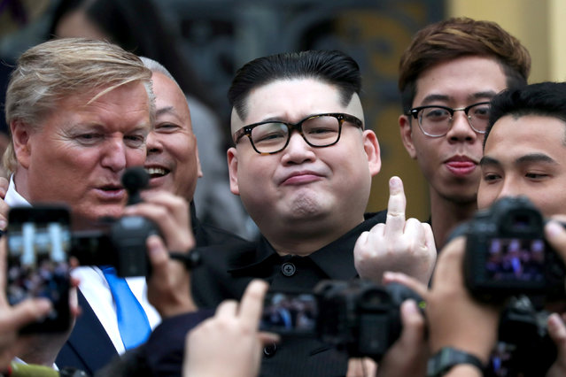 Howard X, an Australian-Chinese impersonator of North Korean leader Kim Jong Un and Russell White, who is impersonating U.S. President Donald Trump, pose for a photo outside the Opera House, ahead of the upcoming Trump-Kim summit in Hanoi, Vietnam, February 22, 2019. (Photo by Athit Perawongmetha/Reuters)