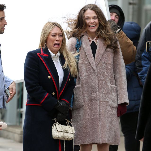 "Actresses Hilary Duff and Sutton Foster grimace and groan in the bitter cold while filming ""Younger"" in Midtown in New York City on February 27, 2019. (Photo by Christopher Peterson/Splash News and Pictures)"