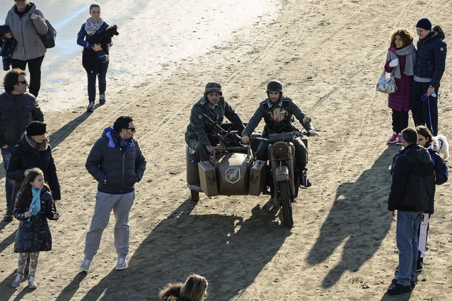 World War II enthusiasts take part in a re-enactment to mark the 70th anniversary of the Allied landings on Anzio beach, 52 km south of Rome, on January 25, 2014. (Photo by Andreas Solaro/AFP Photo)