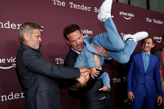 """Director George Clooney and cast members Ben Affleck and Daniel Ranieri attend a tastemaker screening of the film """"The Tender Bar"""" at Directors Guild of America in Los Angeles, California, U.S., October 3, 2021. (Photo by Mario Anzuoni/Reuters)"""