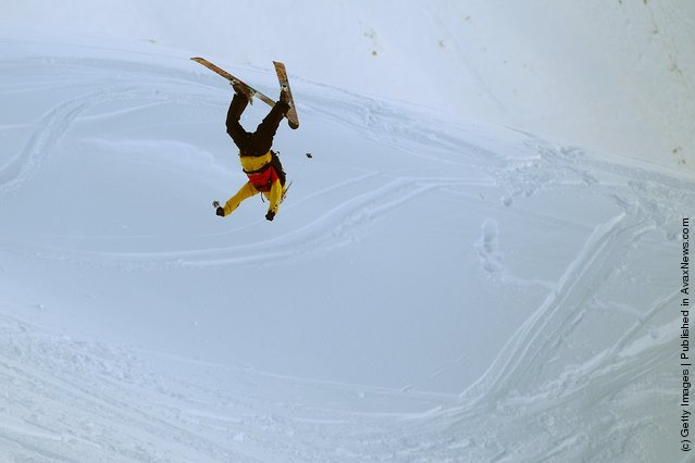 Freeskier Frasor McDougal of New Zealand performs an air during the World Heli Challenge freestyle day in backcountry at Minaret Station on July 31, 2011 in Wanaka, New Zealand