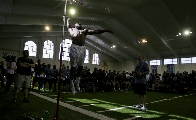 Defensive back Terrell Burt leaps to measure for his vertical jump for NFL scouts during the Pro Day college football workout at Baylor, Wednesday, March 16, 2016, in Waco, Texas. (Photo by L.M. Otero/AP Photo)