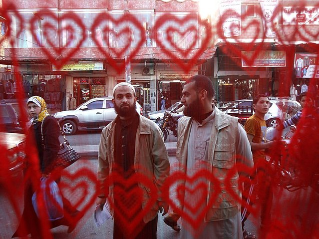 Palestinian Salafists stand outside a shop on the eve of Valentine's day in Rafah in the southern Gaza Strip on February 13, 2014, the Salafists explained to shop owners that this festivity is an invasion of Western culture onto the Islamic culture. (Photo by Said Khatib/AFP Photo)