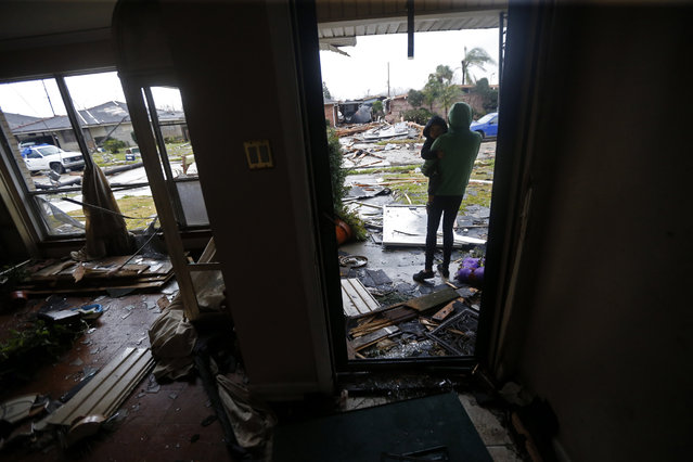 Eshon Trosclair holds her son Camron Chapital after a tornado tore through home while they were inside the New Orleans East neighborhood in New Orleans, Tuesday, February 7, 2017. (Photo by Gerald Herbert/AP Photo)