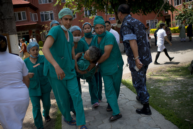 Medics treat an injured person at Police Hospital in Kathmandu following a further major earthquake on May 12, 2015 in Kathmandu, Nepal. A 7.3 magnitude earthquake has struck in Nepal only two weeks after more than 8,000 people were killed in a devastating earthquake. The latest quake has struck near Mt Everest near the town of Namche Bazar. Tremors have been felt as far away as Bangladesh and Delhi. (Photo by Jonas Gratzer/Getty Images)