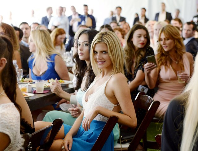 Stephanie Branton, Miss September 2014, and Playboy playmates from over many decades attend 2015 Playboy Playmate of the Year ceremony during a luncheon on the garden grounds of the Playboy Mansion in Los Angeles, California May 14, 2015. (Photo by Kevork Djansezian/Reuters)