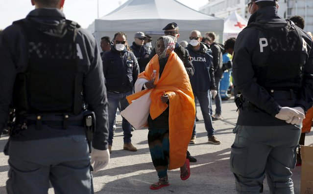 A migrant walks after disembarking from the Norwegian vessel Siem Pilot at Pozzallo's harbour, Italy, March 29, 2016. (Photo by Antonio Parrinello/Reuters)