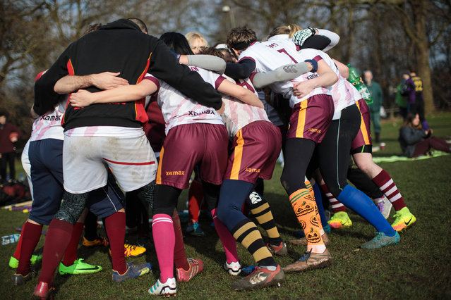 The Werewolves of London quidditch team huddle during the Crumpet Cup quidditch tournament on Clapham Common on February 18, 2017 in London, England. (Photo by Jack Taylor/Getty Images)