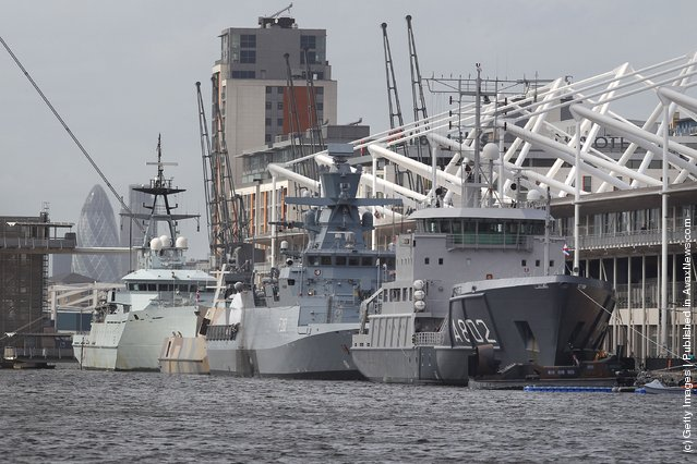 Naval vessels are moored alongside the ExCeL exhibition centre