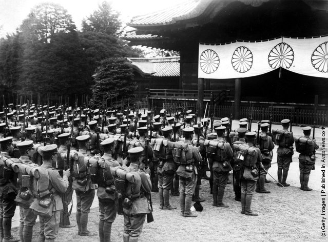 1937: Chinese troops stop at a shrine prior to returning home to the north of China