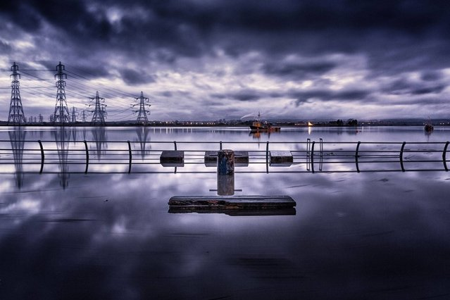 """""""Watching the tide roll away""""; Alloa, Scotland. (Photo by Brian Smith/PA Wire)"""