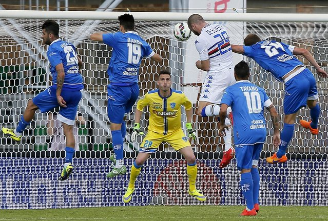 Sampdoria's defender Lorenzo De Silvestri (3-R) in action against Empoli's goalkeeper Davide Bassi (facing) during the Italian Serie A soccer match between Empoli and Sampdoria at Carlo Castellani stadium in Empoli, Italy, 24 May 2015. (Photo by Fabio Muzzi/EPA)