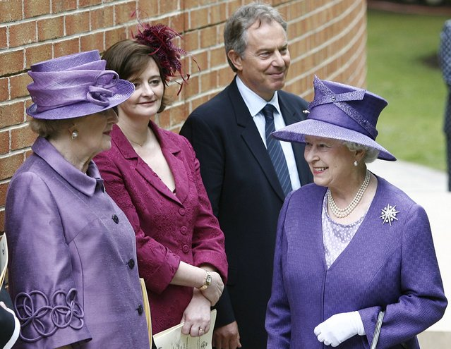 Britain's former Prime Minister Lady Thatcher (L) is greeted by Queen Elizabeth II (R) as she stands with Cherie Blair (2nd L) and former Prime Minister Tony Blair during a service  to commemorate the 25th anniversary of the liberation of the Falkland Islands at Pangbourne College, Berkshire, Britain in this June 14, 2007 file photo. (Photo by Stephen Hird/Reuters)