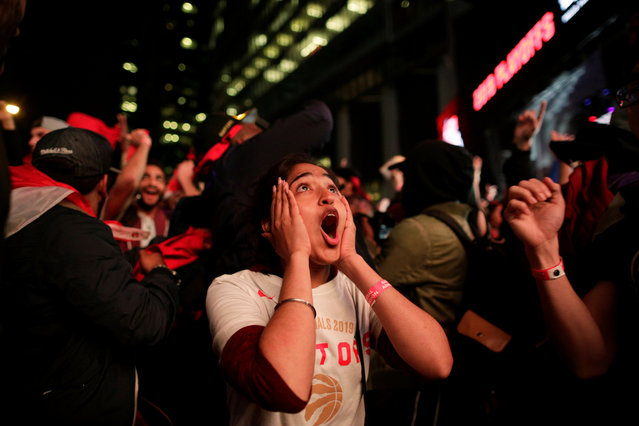 Fans celebrate after the Toronto Raptors defeated the Golden State Warriors in Oakland, California in Game Six of the best-of-seven NBA Finals, in Toronto, Ontario, Canada, June 14, 2019. (Photo by Andrew Ryan/Reuters)