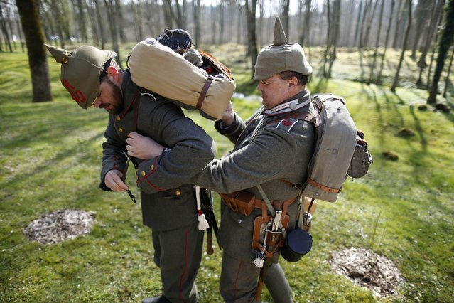 Members of German World War One historical association prepare for a walk at the wiped-out village of Bezonvaux, near Verdun, eastern France, March 29, 2014. (Photo by Charles Platiau/Reuters)