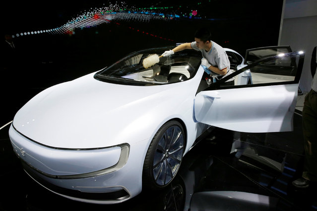 A member of staff brushes off dust from all-electric battery concept car called LeSEE during Auto China 2016 auto show in Beijing, China April 25, 2016. (Photo by Kim Kyung-Hoon/Reuters)