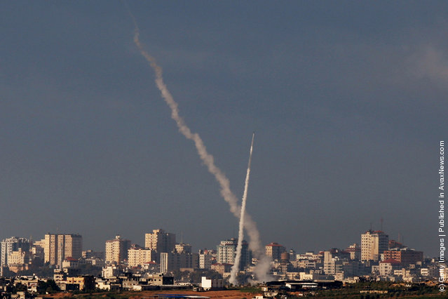 Palestinian rockets are seen as they are launched from Hamas-controlled Gaza