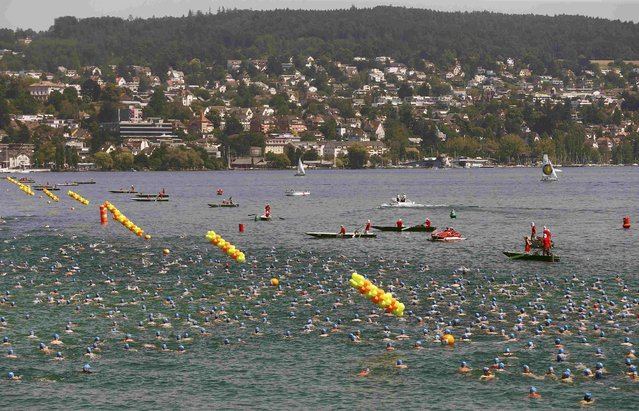 People swim during the annual public Lake Zurich crossing swimming event in Zurich July 1, 2015. (Photo by Arnd Wiegmann/Reuters)