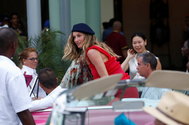 Brazilian supermodel Gisele Bundchen (C) climbs into a vintage car to attend a fashion show by Chanel, the first major fashion house to send models down the catwalk in Cuba, in Havana, May 3, 2016. (Photo by Reuters/Stringer)