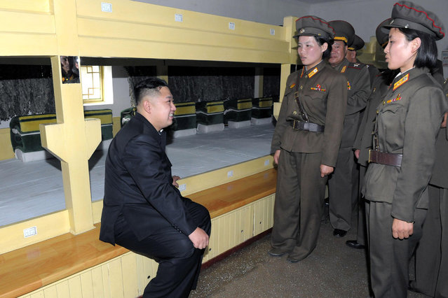 Photo released by Korean Central News Agency on Aug. 7, 2012 shows Kim Jong Un (L), top leader of the Democratic People's Republic of Korea (DPRK), talking to soldiers in a dormitory of a contingent of Unit 552 of the Korean People's Army on August 6, 2012. (Photo by KCNA/Xinhua/SIPA Press USA)