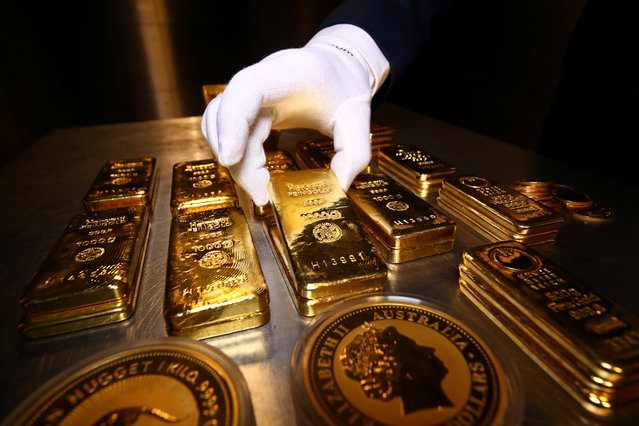 Gold bars and coins are stacked in the safe deposit boxes room of the Pro Aurum gold house in Munich, Germany, August 14, 2019. (Photo by Michael Dalder/Reuters)