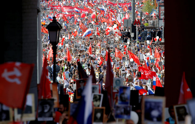 People hold pictures of World War Two soldiers as they take part in the Immortal Regiment march during the Victory Day celebrations, marking the 71st anniversary of the victory over Nazi Germany in World War Two, at Red Square in Moscow, Russia, May 9, 2016. (Photo by Sergei Karpukhin/Reuters)