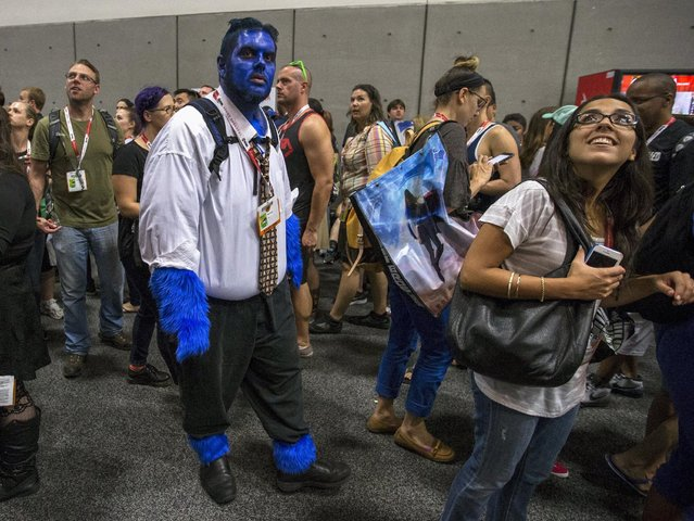 Cosplay enthusiast walks the floor walks the floor during the 2015 Comic-Con International Convention in San Diego, California July 10, 2015. (Photo by Mario Anzuoni/Reuters)