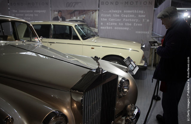 A musuem visitor looks at a Rolls-Royce Silver Cloud II that was used in the James Bond film A View To A Kill and is currently being displayed at the Bond In Motion exhibition