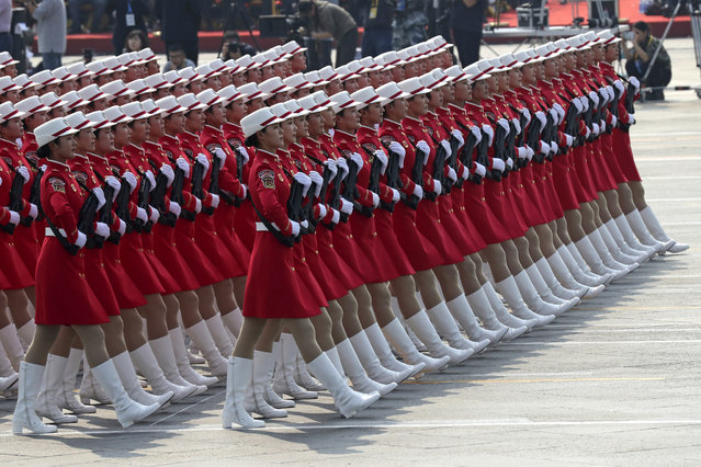 Members of a Chinese military honor guard march during the celebration to commemorate the 70th anniversary of the founding of Communist China in Beijing, Tuesday, October 1, 2019. (Photo by Ng Han Guan/AP Photo)