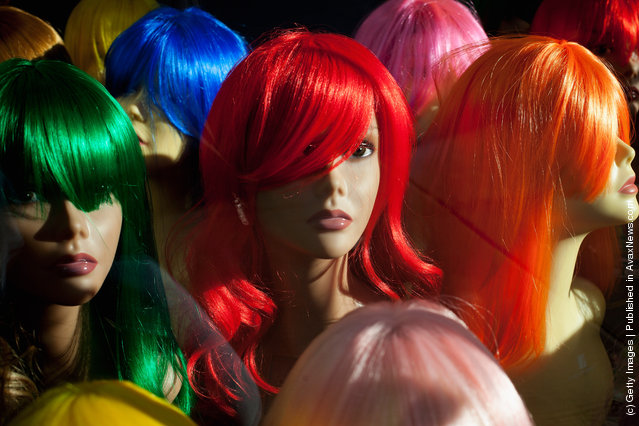 Shop mannequins wearing wigs are displayed in a hair and beauty store in Brixton