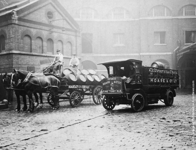 1922: A horse-drawn cart and an electric lorry at Hoare and Co's Brewery