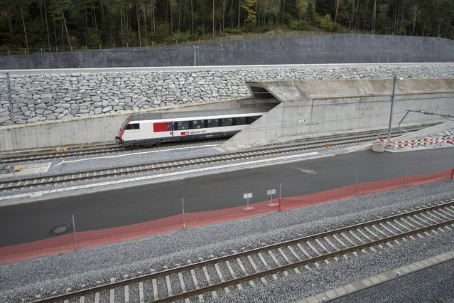 In this October 8, 2015 file photo a test train drives close to the northern gate near Erstfeld, Switzerland. The celebrations of the opening of the Gotthard  Base Tunnel  will start on June 1, 2016. With a length of 57 km (35 miles) crossing the Alps, the Gotthard Base tunnel is the  world's longest train tunnel. (Photo by Urs Flueeler/Keystone via AP Photo)
