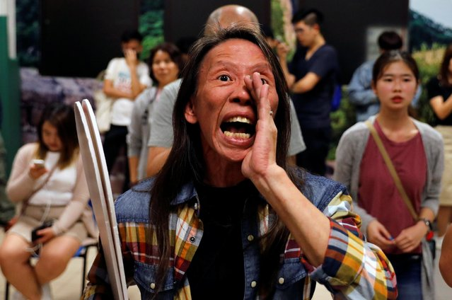A woman reacts during the counting of the votes of the Hong Kong council elections, in a polling station in Hong Kong, China on November 25, 2019. (Photo by Adnan Abidi/Reuters)