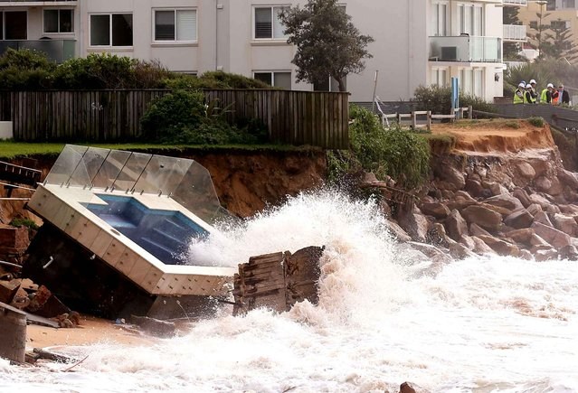 A swimming pool is dislodged and lays on a beach after storms undermined the pilings at Collaroy Beach in Sydney, Monday, June 6, 2016. Storms have lashed Australia's easter coast for several days. (Photo by Rick Rycroft/AP Photo)
