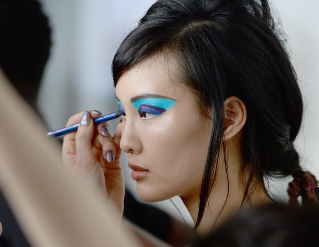 A model is seen backstage, having makeup applied, ahead of the Casely-Hayford show during The London Collections Men SS17 at BFC Show Space on June 11, 2016 in London, England. (Photo by Jeff Spicer/Getty Images)