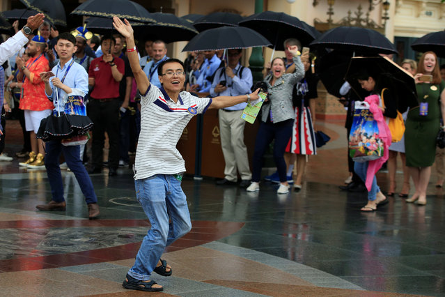 The first visitor reacts as he enters the Shanghai Disney Resort after the opening ceremony of the Shanghai Disney Resort in Shanghai, China, June 16, 2016. (Photo by Aly Song/Reuters)