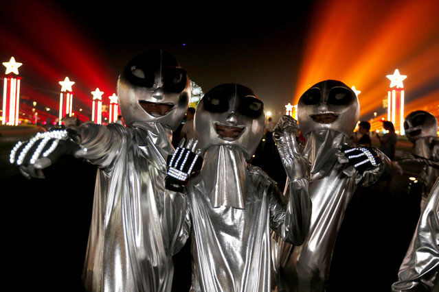 Entertainers wearing alien costumes pose for photos during the parade at the opening ceremony of the 25th China Qingdao International Beer Festival at the West Coast Square in Qingdao city, eastern China's Shandong province, August 7, 2015. The annual festival was launched in 1991 and is held from August 08 to 30 in 2015 during the tourism season. (Photo by Wu Hong/EPA)