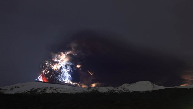 The Iceland volcano Eyjafjallajokull erupt on April 19, sending out a plume of ash and lightning and offering a rare glimpse at the mysterious electrical phenomenon known as a dirty thunderstorm