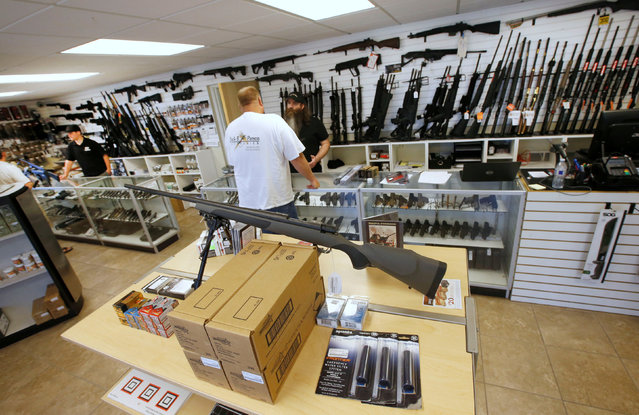 """Prospective buyers look at guns at the """"Ready Gunner"""" gun store in Provo, Utah, U.S., June 21, 2016. (Photo by George Frey/Reuters)"""