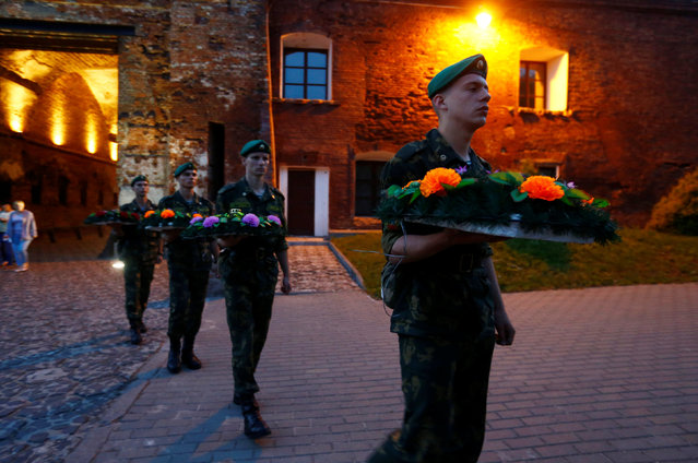 Belarussian border guards take part in a wreath laying ceremony at the memorial at Hero fortress as they mark the 75th anniversary of the Nazi Germany invasion, in Brest, Belarus June 22, 2016. (Photo by Vasily Fedosenko/Reuters)